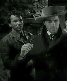 Cameron Mitchell and Dale Robertson in The Outcasts of Poker Flat, 1952