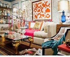 I love the basic colored sofa with pops of color in the accents. Easy to change your mind as often as you wish and it's easier on the wallet.