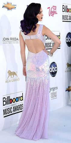 Purple sure is Katy Perry's favorite color these days. The pop star stuns in a lovely open-back lavender sequined gown, matching amethyst locks and on-trend dark lips.