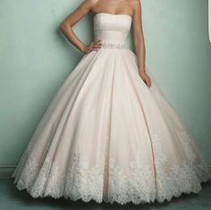 Allure Ballgown Wedding Dress  New With Tags Never Worn still in bag from Lowe's Bridal (Brinkley, AR).  Ivory & Silver   Size 8 No alterations.   English net ballgown ruched at the bodice with Swarovski Crystals at the waist band.  Price is Negotiable  Serious Inquires Only