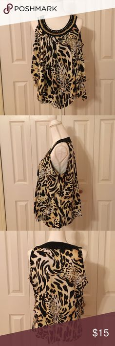 Sleeveless Tiered Top Get your sexy on with this sassy leopard print shirt. Tops Blouses