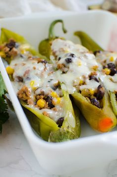 Stuffed Hatch Peppers - delicious spicy hatch chiles stuffed with ground turkey, black beans, corn, salsa, and topped with monterey jack cheese. Easy and healthy dinner!