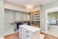 This Almond melamine walk-in designed for the Homearama Showcase features overhead hanging space, pull out pant racks and shoe racks, and detachable fabric laundry hampers.  Designed by Closet Factory Hampton Roads  Learn more here: https://www.closetfactory.com/custom-closets/ Pants Rack, Closet Island, Laundry Hamper, Laundry Rooms, Shoe Racks, Closet Shelves, Big Closets, Dream Closets, Hampton Roads