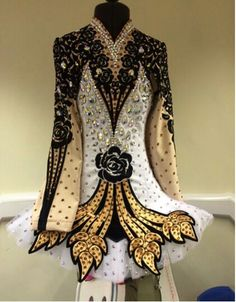 ;Looks like a cape is pinned to the front.  Don't think I like it. Celtic Star Irish Dance Solo Dress Costume