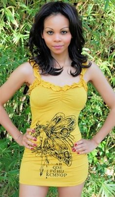 yellow ruffle trim tunic top is stretchy with a pretty fairy print on it, sexy tunic tops, tunic fairy tops that are tunic tops, sexy tops w fairy print, ruffled tops in yellow, trendy tops in yellow, trendy top with fairy print, casual top, day tops
