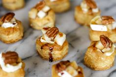 Baked Brie Bites -- these delicious baked brie bites are topped with diced pears, toasted pecans and a drizzle of balsamic reduction for a fabulous holiday appetizer! | unsophisticook.com