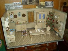 German doll kitchen decorated for Christmas.  Age not noted.  Size:  72 x  35.5 x  43 cm.