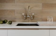 Our wall-mounted Ionian saving sink space in this gorgeous @cueandcompany kitchen!