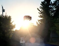 FLYING CARS by Matthew Porter    It's not quite the future, but Matthew's photos capture various cars General Lee'ing in that direction.    Artist: website (via: arpeggia)    (via ianbrooks)