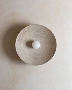 "Interior Design Addict: CONCENTRIC 15"" — our newest size Concentric Sconce in our new bleached walnut finish — on view @addesignshow booth M108 through Sunday 