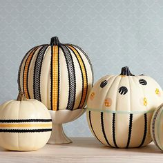 Washi tape and ribbon are easy ways to decorate Halloween pumpkins! Find more ideas here: http://www.bhg.com/halloween/pumpkin-carving/cool-halloween-pumpkins/?socsrc=bhgpin091014prettytapeandribbons&page=6