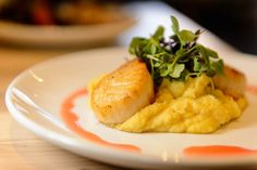 (Trent Nelson  |  The Salt Lake Tribune)  Htenia (seared scallops, yellow split pea puree, micro greens, citrus-ouzo vinaigrette) at Manoli's, a new Greek restaurant in Salt Lake City specializing in small plates.
