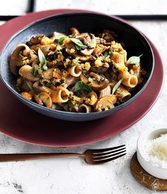 This recipe for rigatoni with mushrooms pecorino and herb crumbs is a quick and comforting recipe for a weeknight dinner.