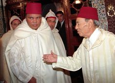 Above the former heavyweight boxing champion Muhammad Ali, left, is greeted by Moroccan King Hassan II, right, as he leaves the King Hassan Palace in Rabat, Morocco in 1998
