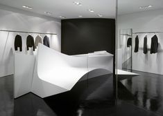 Milan based Neil Barrett Shops by Zaha Hadid | abstract volumes as fixtures
