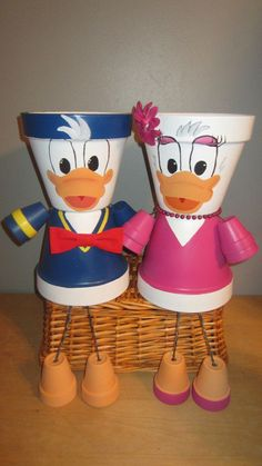 Donald Duck &/ or Daisy Duck Flower Pot People, Clay . Clay Pot Projects, Clay Pot Crafts, Diy Clay, Diy And Crafts, Flower Pot Art, Clay Flower Pots, Flower Pot Crafts, Flower Pot People, Clay Pot People