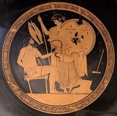Hephaestus gives Tethys forged weapons for Achilles. The Greek god Hephaestus, sitting, finishes with the hammer the helmet of Achilles. The nereid Thetis, the mother of the hero, examines the shield and spear. Attic red-figure kylix, 490 BCE