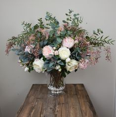 Everyday arrangement with peonies, eucalyptus, roses, pepper berry, etc.