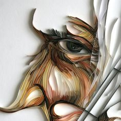 Yulia Brodskaya… paper art or sublime quilling. Art and illustration examples are in her online gallery.