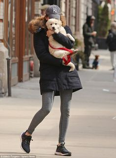 So cute: The actress couldn't keep her hands off the Golden Retriever mix as she strolled through Manhattan
