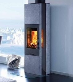 Heat retaining Wood burning stove with soapstone and long glass side panels. Winner of the red dot design Award. High Design, Red Dot Design, Soapstone Stove, Wood Burner, Open Plan Living, Design Awards, Home Appliances, Interior Design, Side Panels