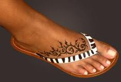 Foot Henna Tattoo Design to suit Flip-Flops Foot Henna Tattoo Design to suit Flip-Flops Rosary Foot Tattoos, Star Foot Tattoos, Tribal Tattoos, Anklet Tattoos, Foot Tattoos For Women, Tattoos Skull, Feather Tattoos, Trendy Tattoos, Body Art Tattoos