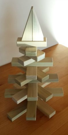 Here's a quick Christmas activity for kids. Build this cute Christmas tree from wooden blocks. Even little ones can make this project in only a few minutes.Find complete instructions at http://backtoblocks.com/blog/backtoblocks_blog_christmas_tree_from_wooden_blocks/