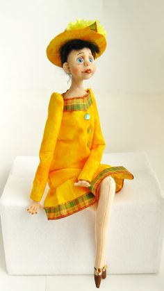 Handmade art doll made of clay and cloth