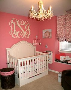 Elegant pink black and ivory baby girl nursery room fit for a princess with large circular shape wooden wall letters monogram