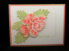 """I am in love with Rosie Posie and the coordinating dies which I have used here and then layered with dimensional foam.  The peonies were stamped with Sweet Blush Ink then a variety of  Copic Markers were added.  The leaves are stamped with Spring Moss Ink as is the frame and """"Mom"""" from Framed.  The card base is Spring Moss and the mat layer is Berry Sorbet."""