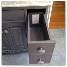 Outlet in bathroom vanity - such a great idea!