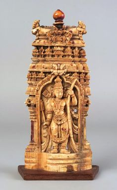 An Indian ivory plaque of Rama, century, carved in shallow relief within a niche of a large multi-tiered temple, on a later wooden stand, high (VAT charged on hammer price) - Price Estimate: - Mysore Painting, Statue Base, Dhoti Saree, Buddhist Shrine, Asian Sculptures, Hindu Statues, Wooden Statues, Stone Sculpture, Hindu Art