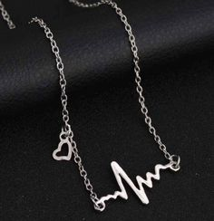 Silver Plated Heartbeat Pendant and Necklace #silver #heartbeat #medicine #pendant #necklace #jewellery http://m.ebay.co.uk/itm/Free-Gift-Bag-Silver-Plated-Heart-Beat-Pendant-Necklace-Jewellery-Medicine-Xmas-/282083795977?nav=SELLING_ACTIVE