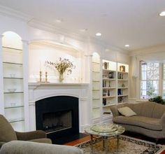 Custom Made Fireplace Mantle With Bookshelves - LOVE this