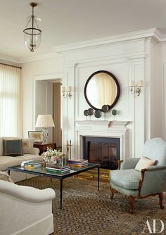 Interior Design Mariette Himes Gomez - Sconces overmantel with mirror via Architectural Digest - photo- Roger Davies