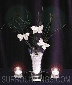 Butterflies alight floating candle centerpiece