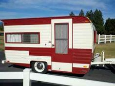1969 Cardinal Travel Trailer. I am thinking red and white or turquoise and white when we get around to fixing one up....ms