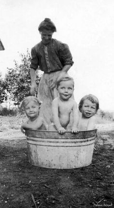 vintage photograph of little girl bath time
