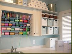 ooh. gift wrap/craft organization in the laundry room.