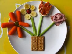 Graham cracker, carrots, celery, banana slices. bread & jam. strawberry, and lunchmeat make this fun lunch.