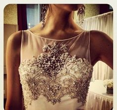 Sheer illusion neckline...and look at all that gorgeous detailed beading! Such a classy looking wedding dress for sure!