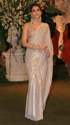 Kriti Sanon Sizzles In Manish Malhotra's Exquisite Saree As She Arrives For Ganesh Darshan At Ambani House - HungryBoo Designer Sarees Wedding, Bollywood Designer Sarees, Designer Party Wear Dresses, Indian Designer Outfits, Bollywood Saree, Western Dresses For Women, Indian Bridal Fashion, Indian Bollywood Actress, Indian Beauty Saree