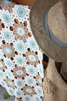 Beautiful colours in these crochet flowers by Eugenia...the ice blue and neutrals are perfect together.
