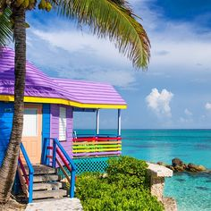 """Wake up to rainbows rain or shine at the one-of-a-kind Compass Point Resort in The Bahamas. There are just 18 of these candy colored cottages perched on a…"""