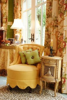 There is so  much to love here; pillows, skirted table, curtains but the scalloped skirt on the tufted chair is what caught my eye.