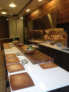 The new Greenfield Cabinetry kitchen has been installed at Chicago's Merchandise Mart! It is in the front window of The Chopping Block Cooking School - which about 15,000 people per day, pass by! Featuring frameless cabinetry, Textured European Oak in a Timber stain. #GreenfieldCabinetry #CustomCabinetry #TexturedEuropeanOak #ChoppingBlock #Chicago #OrganicContemporary #Trend #Cabinets #KitchenDesignPicture #KitchenDesignPhoto #Image