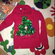 Ugly Christmas sweater complete with lights !