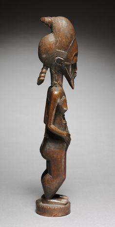 Male Figure, Guinea Coast , Ivory Coast, Baule wood, Overall: 44.8 x 9.3 x 7.7 cm (17 5/8 x 3 5/8 x 3 in.). | Cleveland Museum of Art