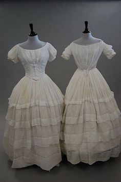 1850s whitework embroidered garments, comprising: two muslin dresses with tiered flounces to the skirts, bodices now attached; a muslin skirt embroidered with grapes