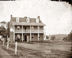 The photograph, taken by James F. Gibson, is of the Farmer's Inn and Hotel, in Emmitsburg, Maryland where Alexander Gardner was captured by J.E.B. Stuart, on July 5, 1863.